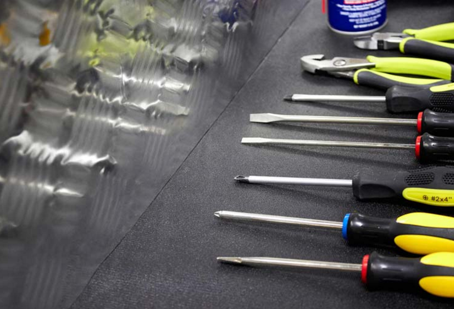 Some screwdrivers stored with Zerust's tool box drawer liner.