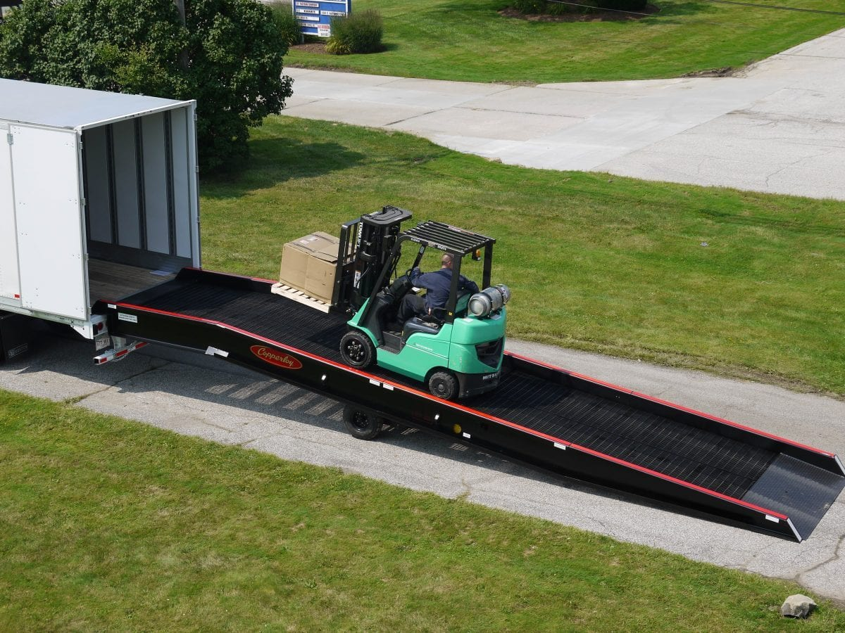 A forklift traveling up one of Copperloy's loading ramps.